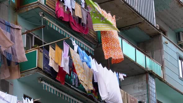 Thumbnail for Clothes Hanging and Drying on a Rope on a Multi-story Building in a Poor District of the City
