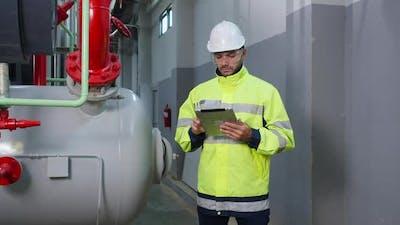 Engineer using digital tablet inspect