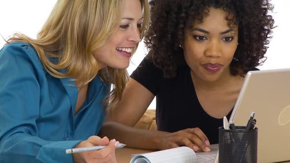 Thumbnail for Two businesswomen working on laptop together