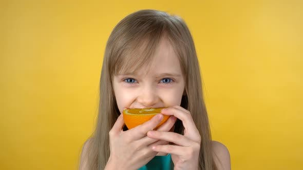 Thumbnail for Cute Girl Biting Sour Orange