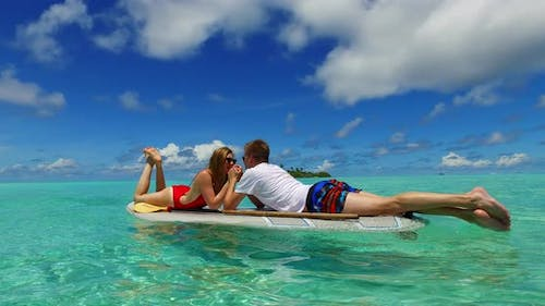 Beautiful lady and man on honeymoon vacation spend quality time on beach on paradise white sand back