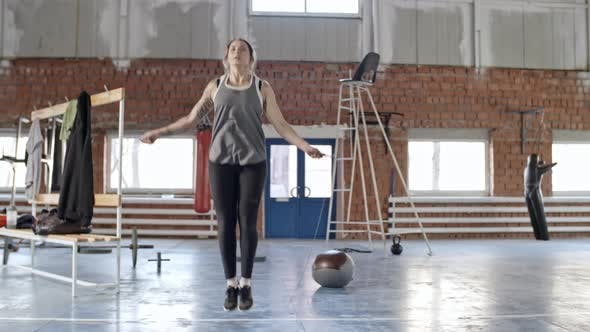 Thumbnail for Athletic Woman Jumping the Rope