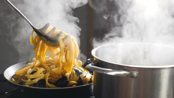 Chef Serving Pasta on Plate