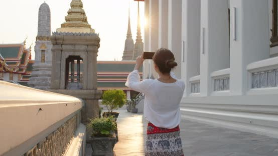 Thumbnail for Woman go travel and take photo on cellphone at bangkok