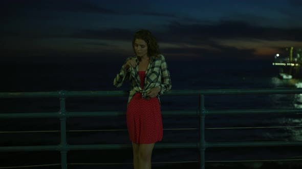 Thumbnail for Young woman on Santa Monica Pier, at night