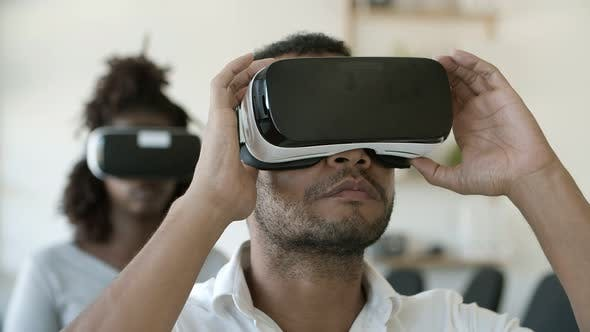 Cover Image for Focused African American User Wearing VR Glasses