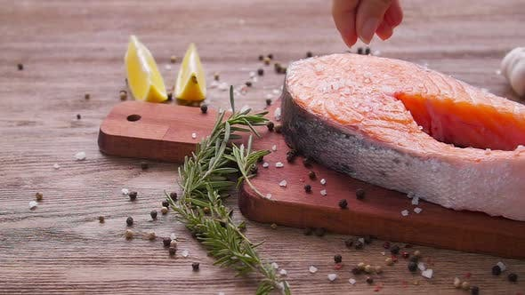 Thumbnail for Seafood and Cooking Concept. Fresh Raw Salmon Steak with Spices