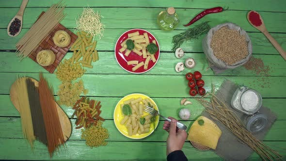 Thumbnail for Tasting Pasta on colourful Plates with Spinach.