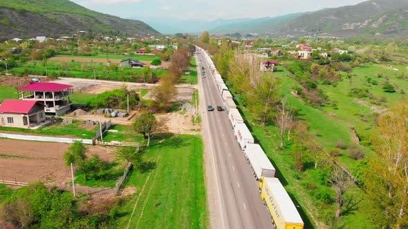 Line Of Lorries Standing On Highway