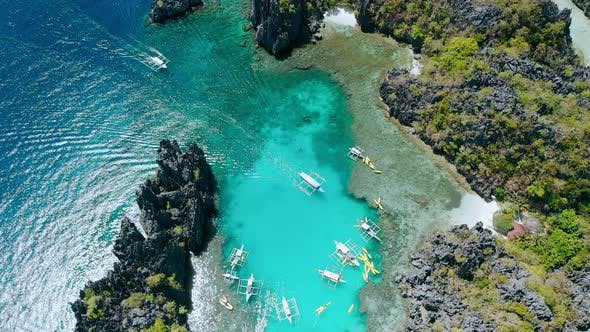 Thumbnail for Aerial Top Down View of Tourist Boat Arriving Into the Small Lagoon in El-Nido, Tour A, Palawan