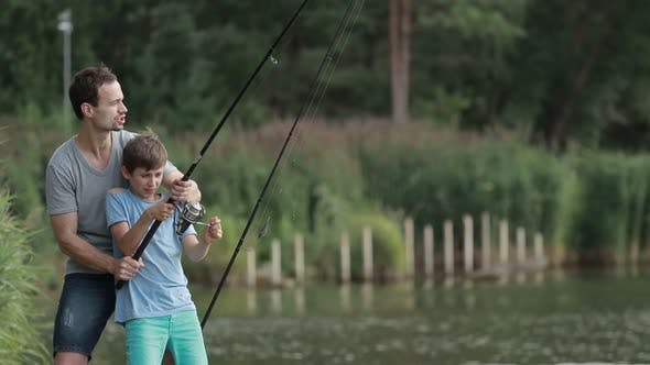 Thumbnail for Excited Son and Father Caught Fish on Bait in Pond