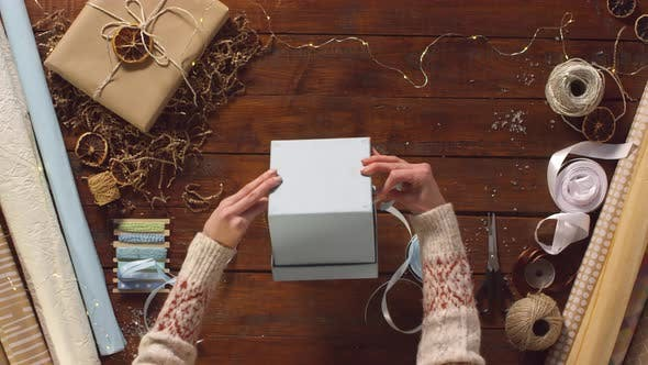 Thumbnail for Hands of Woman Tying a Ribbon Bow on Gift Box