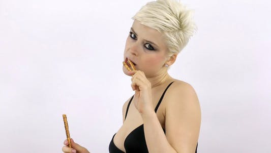 Thumbnail for Woman Eating Cracker