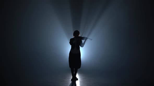 Thumbnail for Girl Plays the Violin a Classic Composition in a Dark Smoky Room