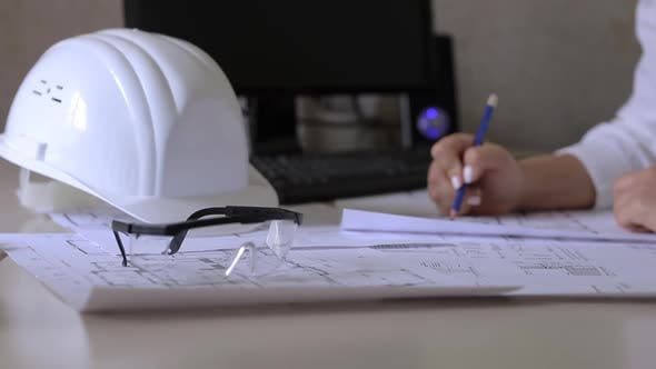 Construction engineer makes notes on the drawings