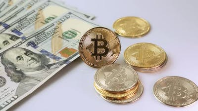 Bitcoin and money on white background.