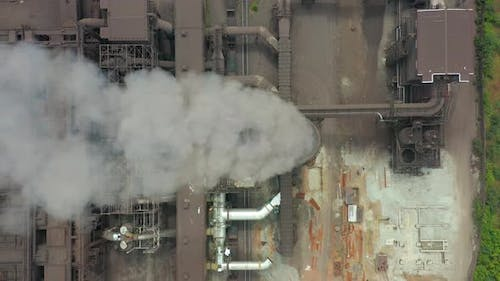 Dirty Smoke and Smog From Pipes of Steel Factory and Blast Furnaces