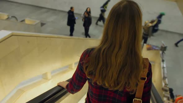 Thumbnail for Long-Haired Woman Descending an Escalator at Shopping Mall, Free Time, City Life