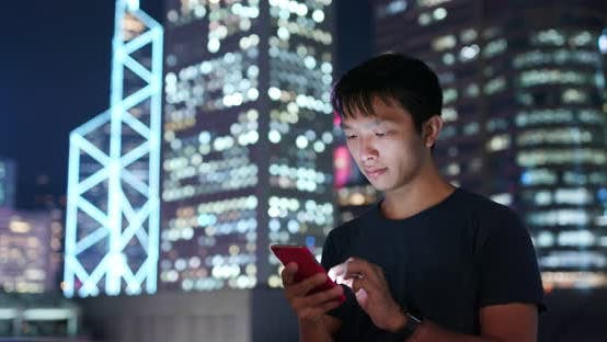 Thumbnail for Man use of mobile phone in city of Hong Kong