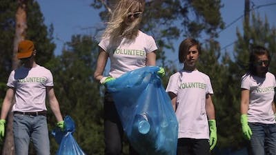 Young People Family Recycle Plastic Bottle Collecting Plastic Waste for Recycling in Green Park on