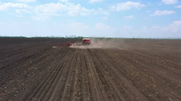 Thumbnail for Tractor With The Seeder At The Field