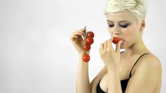 Thumbnail for Woman Eating Tomato