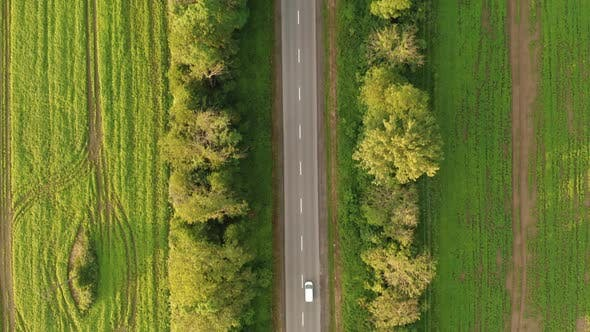 Thumbnail for Aerial Drone Footage Tracking a Car