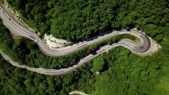Thumbnail for Aerial Fly Under Curved Winding Road Trough the Mountains