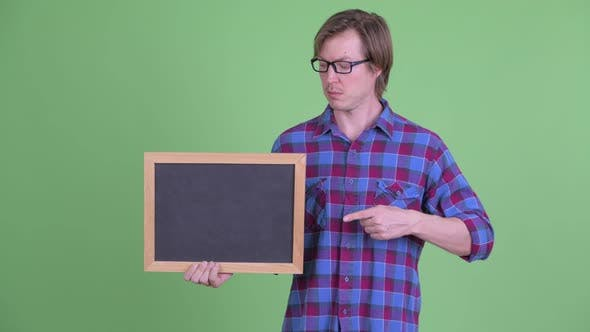 Thumbnail for Young Handsome Hipster Man Holding and Pointing at Blackboard