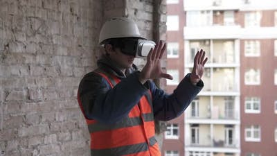 Builder designer designs a room in 3D virtual reality VR glasses.