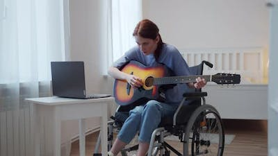 A Disabled Lady is Learning to Play the Guitar