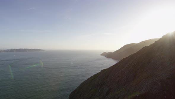 Thumbnail for Pan left of sun shining over Golden Gate Bridge