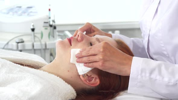 Thumbnail for Cosmetologist Wipes Client's Face with Napkins
