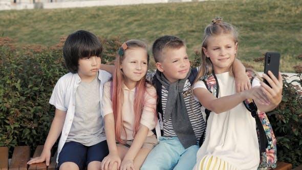 Thumbnail for Happy kids posing making selfie photo using smartphone.
