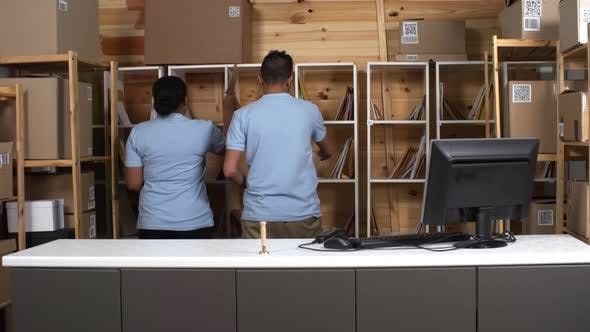 Thumbnail for Male and Female Postal Services Clerks Working behind Counter