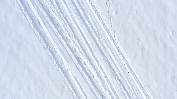 Thumbnail for Vehicle marks and foot steps in the snow