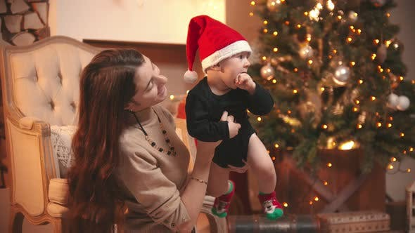 A  Woman Playing with  Baby in Christmas Studio