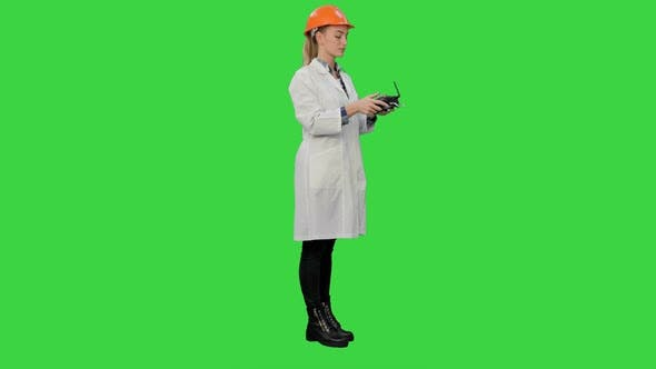 Thumbnail for Female Engineer Correct Parts of an Object Using Remote Controller on a Green Screen, Chroma Key