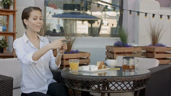 Thumbnail for Woman Photographing Food By Smartphone in Cafe