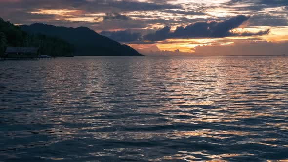 Sunset Over Kri and Monsuar, Calm Waves Moving on the Ocean Surface, West Papua, Raja Ampat