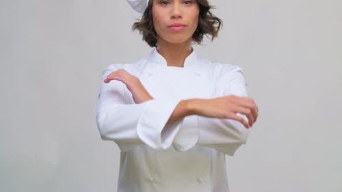 Smiling Female Chef in Toque