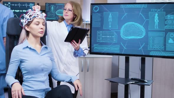Cover Image for Female Scientis in Brain Activity Using Her Tablet To