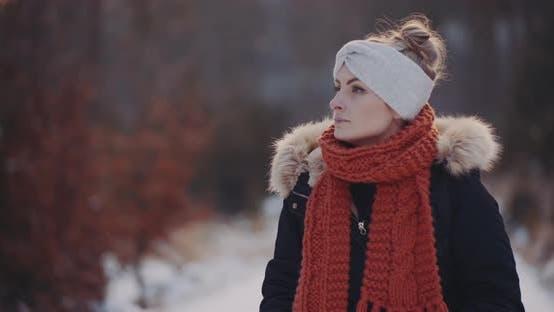 Tourist Walking in Woods in Winter