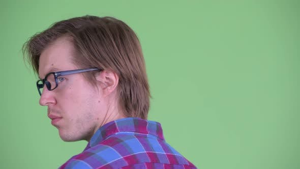 Thumbnail for Closeup Rear View of Young Hipster Man Turning Around