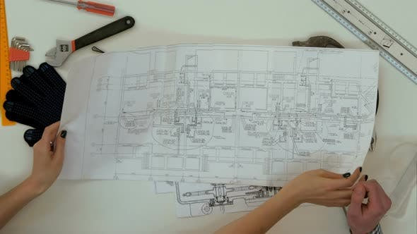 Thumbnail for Architects Working on Blueprints with Divider Compass