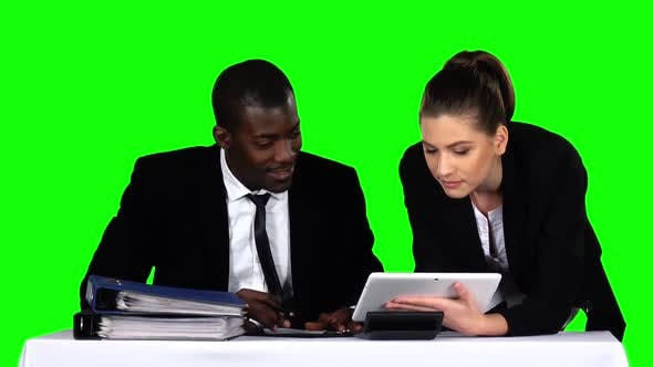 Thumbnail for Business People Examining a Document in Their Office with a Laptop