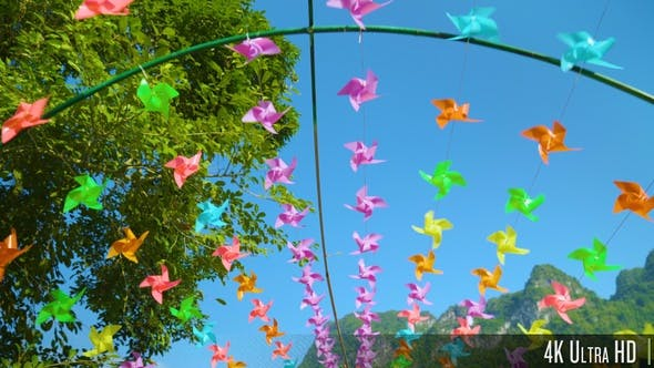 Thumbnail for 4K Many Colorful Pinwheels Spin in the Wind