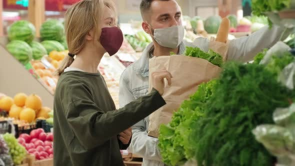 Thumbnail for Couple Shopping for Fresh Produce during Pandemic