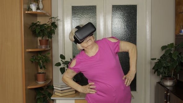 Thumbnail for Grandmother in Virtual Headset Glasses Watching Video in VR Helmet and Training Workout at Home