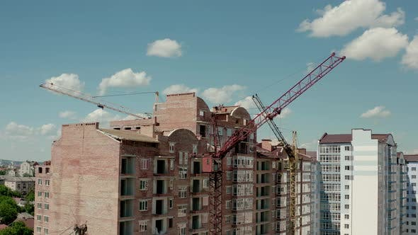 Thumbnail for Aerial Drone View of Construction Cranes in Sunny Day. Construction Site Building in City
